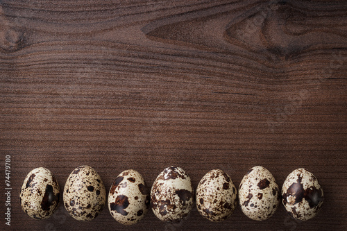 canvas print picture quail eggs on the brown wooden table background