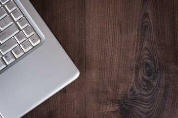 laptop on brown wooden background