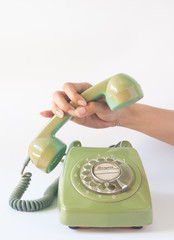 Woman holding on the old telephone