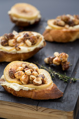 bruschetta with cheese, apple and walnuts