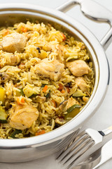 prepared pilaf with rice and chicken in pan
