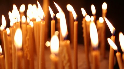Burning candles in church altar Part III