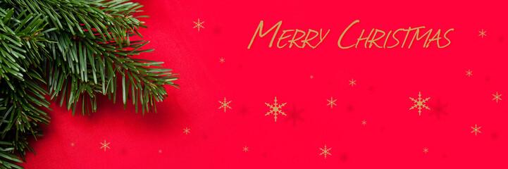 bannière joyeux noël avec branche de sapin et fond rouge