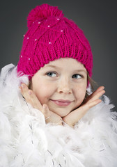 Funny little girl wearing knitted cap