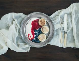 Breakfast set: curd pancakes with yogurt, fresh blueberry and ra