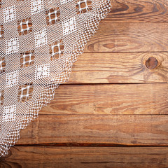 Wood texture, wooden table with white lace tablecloth top view.