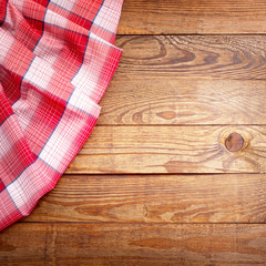 Wood texture, wooden table with red tablecloth tartan top view.