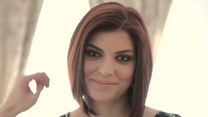 Fashion Model has hair fixed and smiles sensually