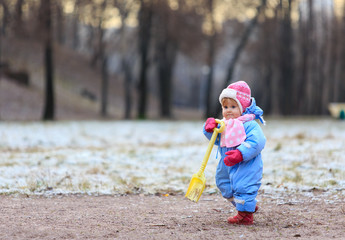 little girl making first steps in winter
