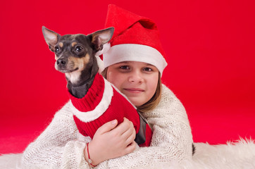 Christmas portrait with small dog and girl