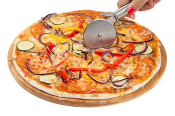 round pizza cutter in a female hand