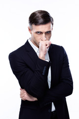 Portrait of a pensive businessman isolated on a white background
