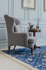 classical grey chair style on blue pattern carpet