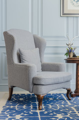 classical grey chair style on blue pattern carpet at home