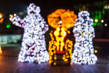 Santa Claus and Snow White statues brightly lit