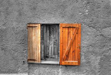 wooden window in a rustic wall