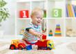 kid boy toddler playing at home