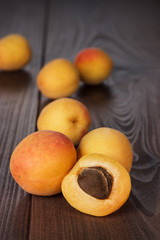 some fresh apricots over wooden background