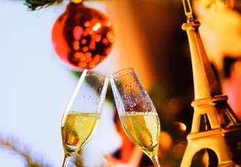 champagne flutes on christmas eiffel decoration background