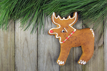 moose handmade gingerbread and fir tree on wooden background