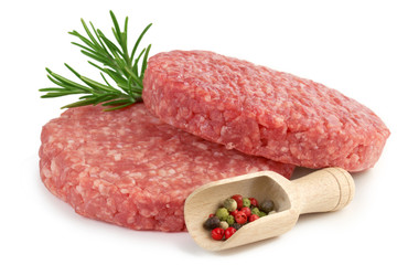raw burgers, rosemary and pepper