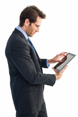 Businessman standing while using a tablet pc