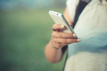 close up hands of woman using smartphone