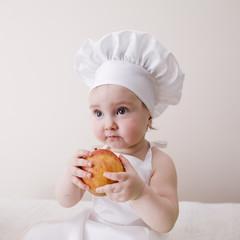 little cook eats an apple