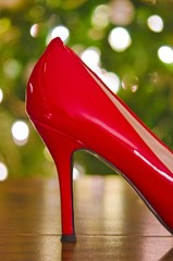 red pumps with Christmas tree bokeh