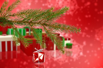 Composite image of red christmas decoration hanging from branch