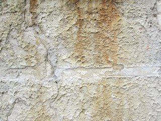 Medieval scratched concrete wall background texture