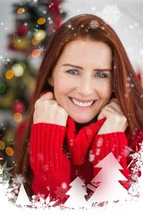 Composite image of festive redhead smiling at camera
