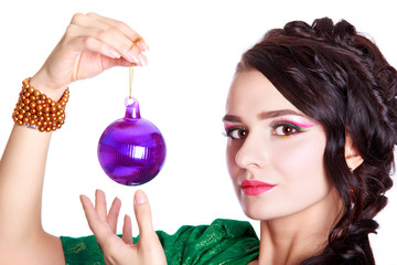 Beautiful young woman with a Christmas bauble