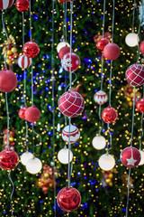 Christmas ball haning on a Christmas tree with defocused lights