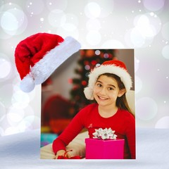 Festive little girl smiling at camera with gifts