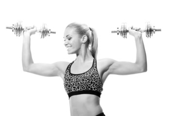 beautiful sporty woman working out with dumbbells