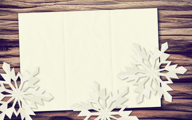 snowflakes paper driftwood