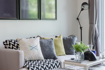 modern living room with row of pillows on sofa