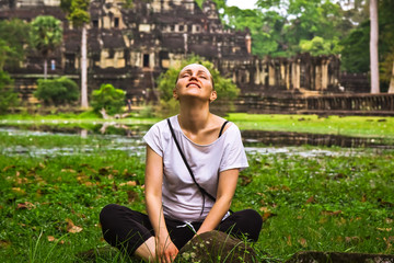 Young woman relax in lotus pose