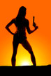 Leinwanddruck Bild - silhouette of woman in bikini gun up