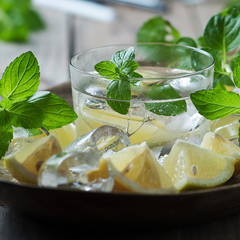 Fresh mojito with lemon, mint, ice and sugar, selective focus
