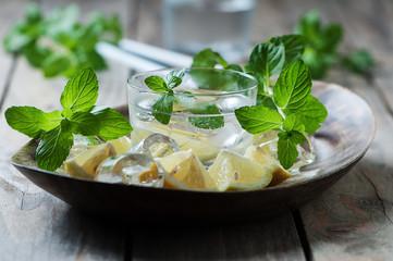 Fresh mojito with lemon, mint, ice and sugar, selective focus