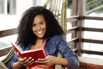 Beautiful black woman read book, and smile