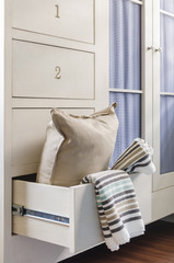 bath towel and pillow in wardrobe