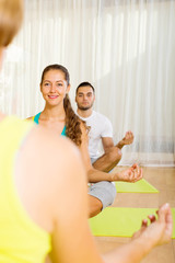 adults at group yoga practice