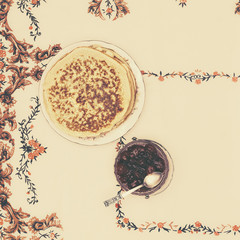 village pancakes with jam on a vintage tablecloth