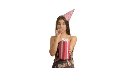 young happy girl buzzing whistle and presents birthday gift