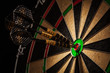 Leinwanddruck Bild - Three darts in bull's eye close up