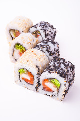 salmon sushi roll in sesame seeds