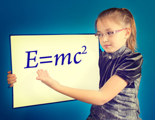 the girl shows the formula written on a plastic board